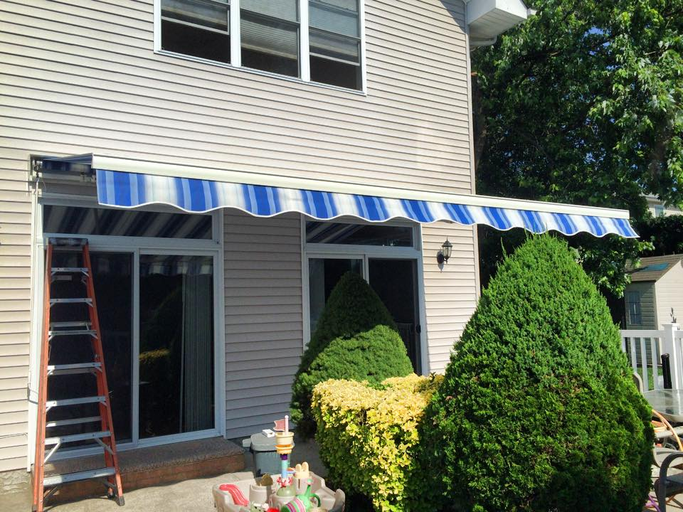 brick retractable by x nj photo awning awnings manual home in manually of one shade
